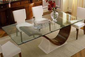 glass table tops can add a touch of elegance to your home decor protection from scratches on your furniture and add a feeling of space with this modern