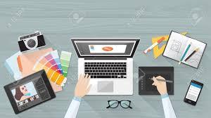 creative office desk. Professional Creative Graphic Designer Working At Office Desk, He Is Designing A Vector Illustration Using Desk