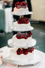 Wedding Cake With Red Roses Stock Photo More Pictures Of Bakery