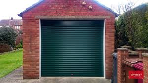 br dark green birkdale insulated roller garage door fitted to detached brick built garage