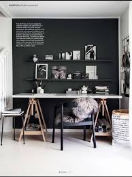 black accent wall for desk space with black floating shelves.