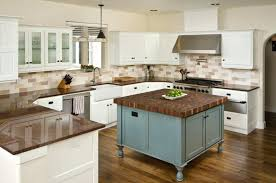 these stunning wood floors are complemented by the island and chocolate brown granite kitchen countertops tan countertop kitchens white cabinets dark