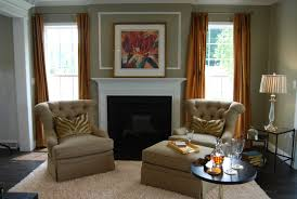 paint colors living room brown brilliant two gray fabric tufted single couch with black round pedestal coffee table and white fireplace