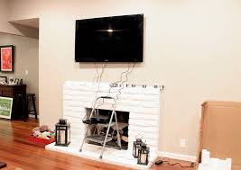 free tv mounted above fireplace where to put cable box with tv mounted above fireplace where to put cable box