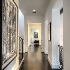 Dark wood floors 2018 White Hallway With Dark Hardwood Floors Havwoods Photos Hgtv