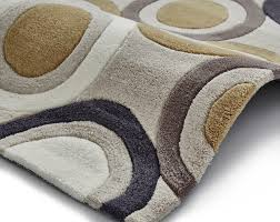 these hong kong rugs are hand tufted and made from 100 acrylic the geometric circles design will inject personality and character into any room and would