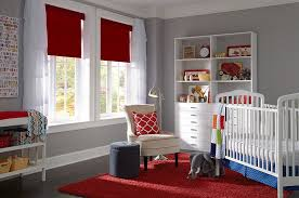 View in gallery Red Roman shades and rug in the nursery keep the space  elegant, simple and lively