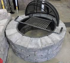 on outdoor stone fire pit kits gas with round stoned shaped and black cover