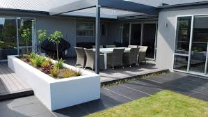 rectangular flamed black granite pavers from urban paving edge the grass in this modern setting