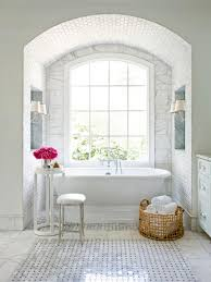white spa bathroom with marble floors