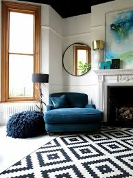 big blue comfy chair and patterned rug in living room 47 park avenue yorkshire