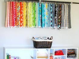 fabric shelves hanging over storage shelf ikea