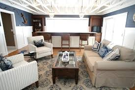 pottery barn jute rug family room traditional with ceiling beams sofas natural light round