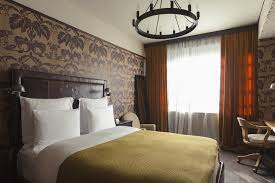 a bed or beds in a room at rooms hotel tbilisi