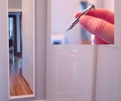 hanging heavy mirror on plaster walls