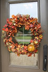 Autumn's blooms, leaves and gourds is an ultimate combo to make a wreath.  Just