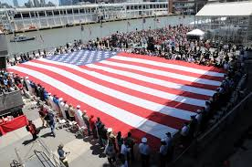 file u s service members and veterans hold a foot u s flag  file u s service members and veterans hold a 100 foot u s flag that was