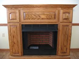 luxury light brown varnishes oak wood fireplace surround and mantels with firebrick and black iron