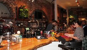 the bar at garden on grand is made of one long slab of red maple