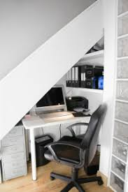 setting up home office. compact home office set up setting