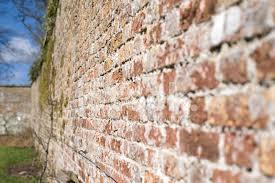 old brick garden wall stock photos