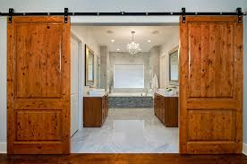 ... Barn doors bring rustic simplicity to the modern bathroom [Design:  Cornerstone Architects]