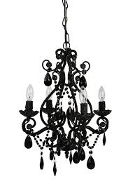 black chandelier with curving shape combined with lamps with candles shape feat semi oval hanging ornaments