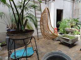 chill atmosphere with oriental rattan hanging egg chair with orang pillow