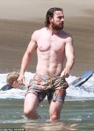 Aaron Taylor-Johnson wears swimming trunks on Malibu beach | Daily Mail  Online