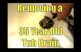 REMOVING A 35 YEAR OLD TUB DRAIN - YouTube