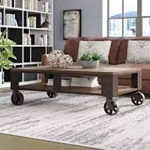 Vintage Industrial Inspired Coffee Table with Large Cast Iron Wheels and Casters