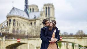 The online dating site sued for targeting married people   BBC News Couple in Paris
