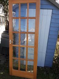 two internal heavy wooden glazed doors 15 pane bevelled glass with fittings great quality