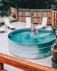 we had our stock tank pool last year and it was set up by our landscaper who also does ponds we knew we wanted our pool to be chlorinated and with the