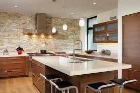 ... Smart contemporary kitchen with lovely lighting and stone accent wall  [From: By Design /