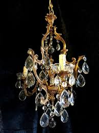 an antique italian pair of gilded brass chandeliers