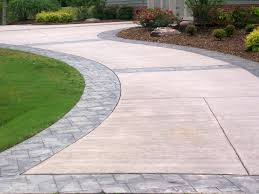 Brand new refinished concrete driveway with decorative stamped pavers