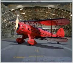 garage door wrapsBillboard Tarpaulins Put Race Cars Tractors and Planes In Your Garage