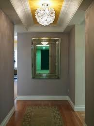 narrow hallway lighting ideas. this long and narrow hallway has a yellow painted ceiling check out the dot pattern lighting ideas