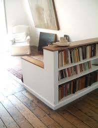 Charming Short Bookshelf As Room Divider With A Built In Trunk Style Storage Bench.