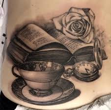 cup rose and back book tattoo