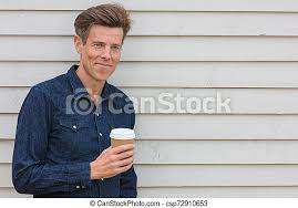 Young indian man drinking coffee near the window and looking at snow outside. Happy Middle Aged Man Drinking Coffee Outside Portrait Shot Of An Attractive Successful And Happy Middle Aged Man Male Canstock