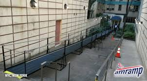 wheelchair ramp for the federal bureau the city of new york closed down the front entrance of this residential apartment building on