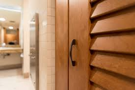 public bathroom partition hardware. ironwood manufacturing toilet partitions and louvered restroom doors with powder coated hardware. clean, traditional public bathroom partition hardware