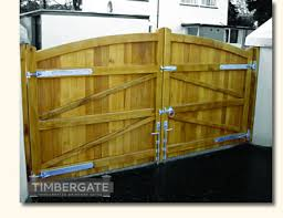 looking for wooden gates or timber garage door for your driveway path garden or house