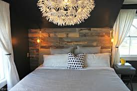 master bedroom reclaimed wood accent wall with stikwood view from the fridge