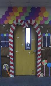 candy canes on the sides of the door but pointing to the outside under the  windows
