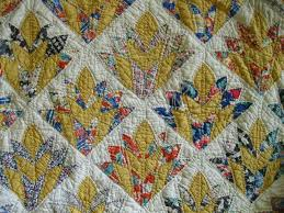 Ann Quilts: Art Deco Addendum & I posted about a week ago about the quilt I repaired with an Art Deco  pattern that I couldn't name. Adamdwight.com