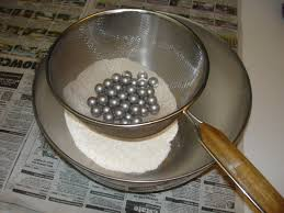 a sieve to separate the from the powder