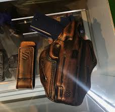 blackhawk introduced several new holsters but this one was our favorite this particular all leather holster is a new concept for blackhawk